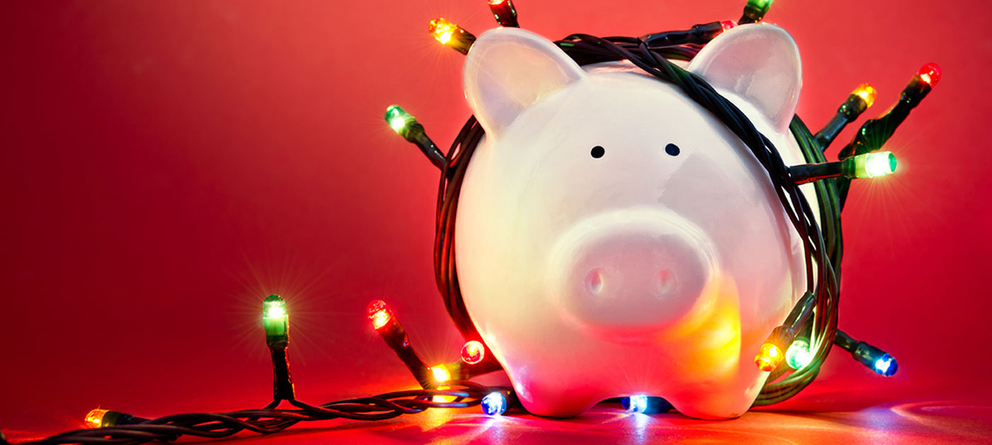 holiday lights covering piggy bank: it's holiday fundraising time again